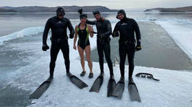 85 meters under the ice: Russian swimmer sets new WORLD RECORD with incredible feat at Lake Baikal (VIDEO)