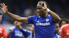 'A difficult decision': Chelsea hero Didier Drogba reveals his marriage is over after video appeared to show him in bed with woman