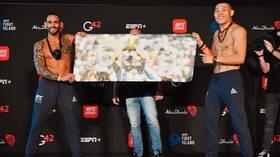 For Diego: UFC star Santiago Ponzinibbio pays tribute to football legend Maradona at Fight Island weigh-ins (VIDEO)