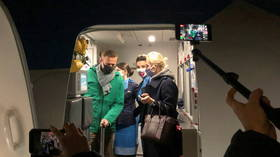 WATCH Russian opposition figure Navalny leave plane in Moscow before being detained