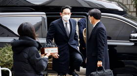 Samsung chief receives reduced 30-month jail term over corruption scandal