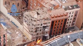 Scale of disaster site after fatal Madrid explosion revealed in aerial footage filmed by Spanish police (VIDEO)