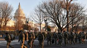 When 25,000 troops aren't enough: Democrats 'WORE BODY ARMOR' to Biden's inauguration in sealed-off Capitol, reports claim