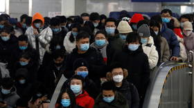 Beijing tightens testing and quarantine rules in effort to curb risks from massive Chinese Lunar New Year migration