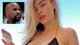 Ring craft: Boxing great Floyd Mayweather dismisses 'rumors and lies' over 'engagement' to lead dancer Anna at strip club he owns