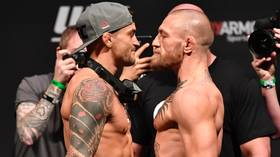 Hot sauce and staredowns: Watch Conor McGregor and Dustin Poirier go face-to-face for the last time ahead of UFC 257 (VIDEO)