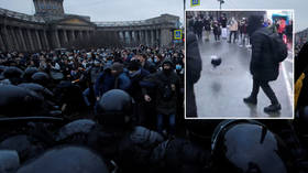 Kicking off: Protestors over imprisoned Kremlin anti-corruption activist Alexey Navalny use riot police helmet as football (VIDEO)