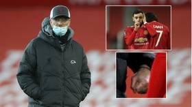 'He can't even look at him!' Fans in hysterics at image of clenched-fist Klopp & Fernandes after Man Utd dump Liverpool out of cup