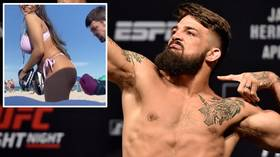 'Let me punch that booty!' UFC star Mike Perry works his boxing on girlfriend's BUTTOCKS during beach workout (VIDEO)