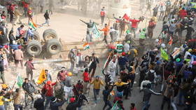 Irate farmers storm Delhi on tractors as tear gas deployed and internet cut off in scramble to defend Indian capital