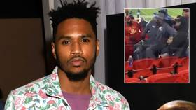 Mask row allegedly led to arrest of rapper Trey Songz after star 'placed police officer in headlock' at NFL game (VIDEO)