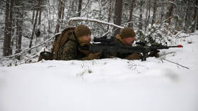 Frosty relations: US Marines equipped for Arctic warfare land near Russian-Norwegian border as tensions heat up in frozen North