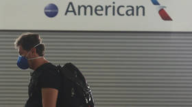 Family of 20 booted off American Airlines flight for 'improper mask-wearing'