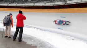 Tough sledding: Russian European champion lugers endure disqualification for using their HANDS at World Championship event (VIDEO)