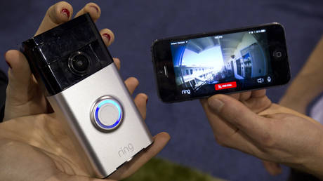FILE PHOTO: A Ring video doorbell (L) is displayed during the 2015 International Consumer Electronics Show (CES) in Las Vegas, Nevada January 7, 2015