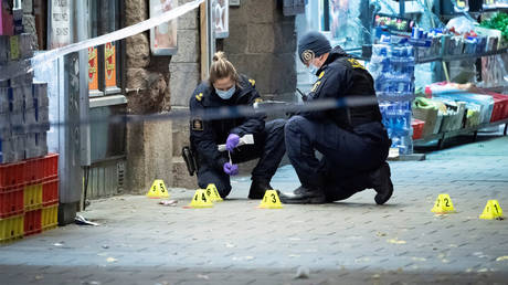 Police forensics examine the crime scene where a 15-year-old was fatally hit and another severely wounded when attackers opened fire on a pizzeria before fleeing the scene on bicycles in Malmo, Sweden November 9, 2019.