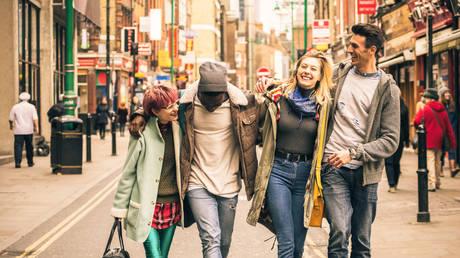 Friends walking on Brick Lane at Shoreditch London