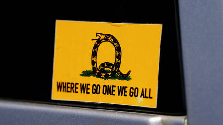 FILE PHOTO: A sticker referencing a QAnon slogan is seen on a truck in Adairsville, Georgia.