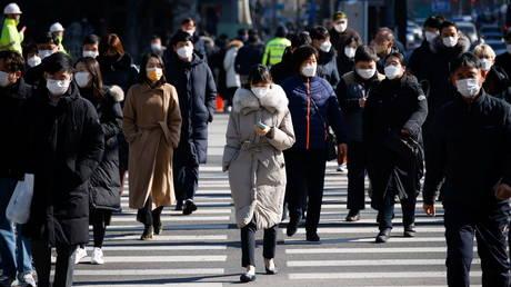 Commuters cross a zebra crossing in Seoul, South Korea on February 3, 2021.