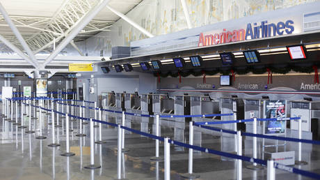FILE PHOTO: An American Airlines counter stands empty at John F Kennedy International Airport in New York December 28, 2009.