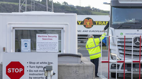 January 01, 2021 an official checks freight from Scotland as truckers disembark a ferry at the Port of Larne in County Antrim, Northern Ireland.