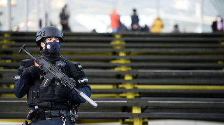 A police officer stands guard outside the court building in Antwerp, Belgium on February 4, 2021.