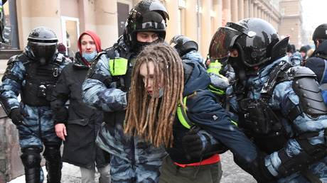 Law enforcement officers detain participants of an unauthorized rally of supporters of Alexey Navalny in Moscow.