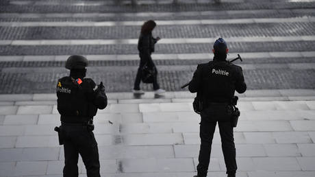 Belgian police officers guard entrance of Antwerp courthouse, February 4, 2021