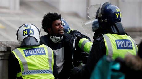 FILE PHOTO: Police officers detain a demonstrator in London