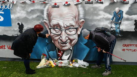 A mural of the late Captain Tom Moore in Two Gates, Tamworth, Britain February 3, 2021. REUTERS/Jason Cairnduff