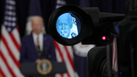 US President Joe Biden is seen through a camera viewfinder while speaking to State Department staff in Washington, DC, February 4, 2021.