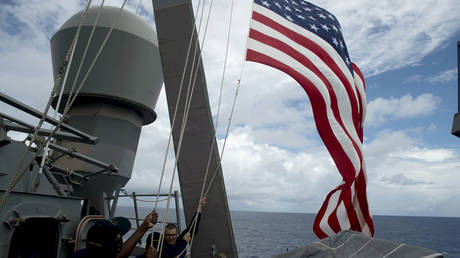 FILE PHOTO: US Navy personnel raise their flag during Cooperation Afloat Readiness and Training (CARAT) Philippines 2014, a U.S.-Philippines military exercise, aboard USS John S. McCain in the South China Sea near waters claimed by China June 28, 2014.