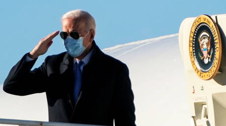 U.S. President Joe Biden salutes while boarding Air Force One as he departs for Washington from Newcastle, Delaware