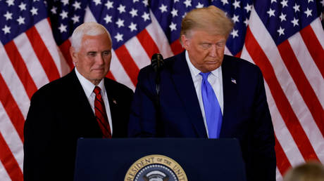 FILE PHOTO: Donald Trump and Mike Pence in the East Room of the White House in Washington, US, November 4, 2020