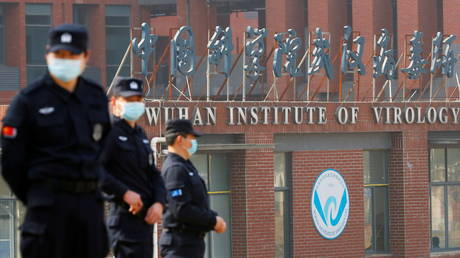 Security personnel keep watch outside Wuhan Institute of Virology in Wuhan, Hubei province, China February 3, 2021.