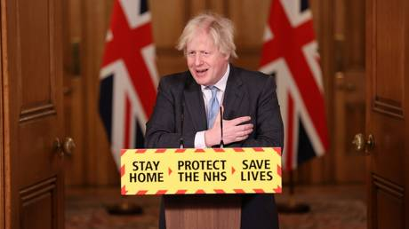 UK Prime Minister Boris Johnson is shown speaking at a Covid-19 briefing on Wednesday in London.