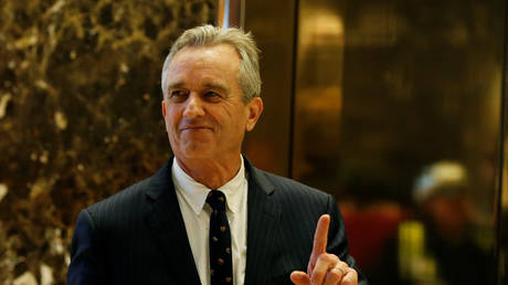 Robert F. Kennedy Jr. gestures while entering the lobby of Trump Tower in Manhattan, New York.