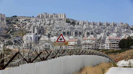 FILE PHOTO: A section of an Israeli barrier is seen surrounding a Jewish settlement near Jerusalem, known to Israelis as Har Homa and to Palestinians as Jabal Abu Ghneim.