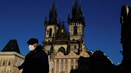 A man wearing a face mask walks across the Old Town Square amid the coronavirus disease (COVID-19) outbreak in Prague, Czech Republic, January 31, 2021.