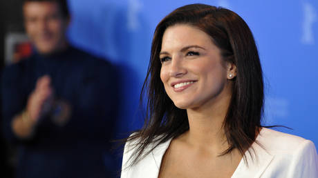 FILE PHOTO: Actress Gina Carano poses for photos at the 62nd Berlinale International Film Festival in Berlin, Germany.