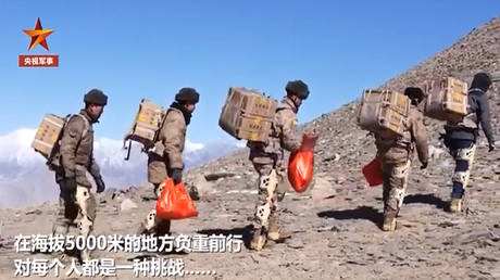 Ho-ho-hiss: Chinese troops in EXOSKELETONS deliver New Year presents to Himalayan outpost (VIDEO)