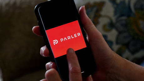 A person using Parler on their phone