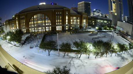 The snow-covered grounds of the American Airlines Center arena are seen amid a severe winter storm in Dallas, Texas, February 15, 2020.
