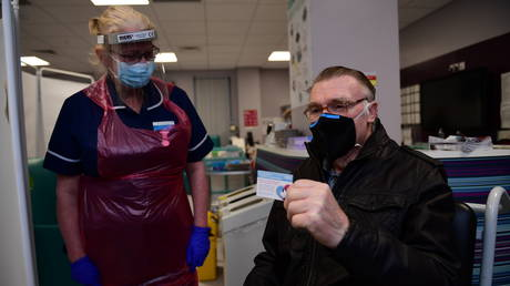 FILE PHOTO: Patient, Anthony Moore shows his Record card after receiving the Pfizer-BioNTech COVID-19 vaccine at the Northern General Hospital, at the start of the largest ever immunisation programme in the UK's history on December 8, 2020 in Bristol, United Kingdom