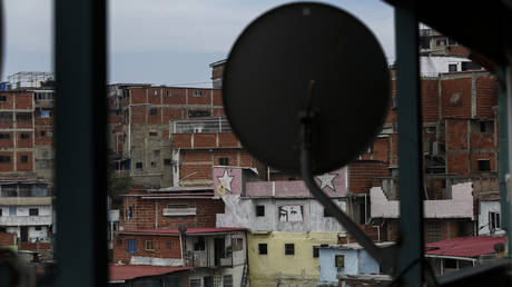 FILE PHOTO: An antenna is located on a terrace after the US television satellite operator DirectTV announced its withdrawal from Venezuela