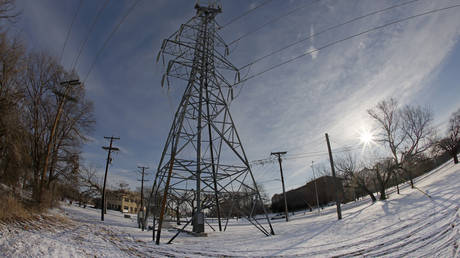 A transmission tower supports power lines after a snow storm on February 16, 2021 in Fort Worth, Texas