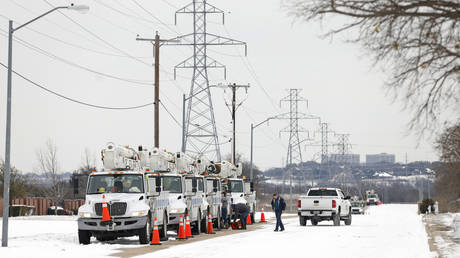 Pike Electric service trucks line up after a snow storm on February 16, 2021 in Fort Worth, Texas, US