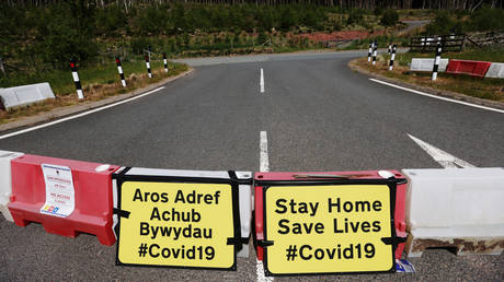 FILE PHOTO: Signs asking people to stay at home are seen near Llwyn-on Reservoir, following the outbreak of the coronavirus disease (COVID-19), Merthyr Tydfil, Wales, Britain, June 2, 2020