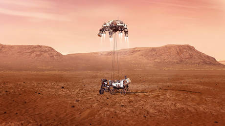 "Undated illustration handout of Perseverance rover being lowered to Martian surface by jet-powered ""sky crane"" descent vehicle"