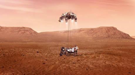 """Document d'illustration non daté du rover Perseverance abaissé à la surface martienne par propulseur à réaction """"grue du ciel"""" véhicule de descente"""